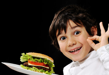 Kid serving burger