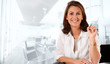Smiling woman in a business environment