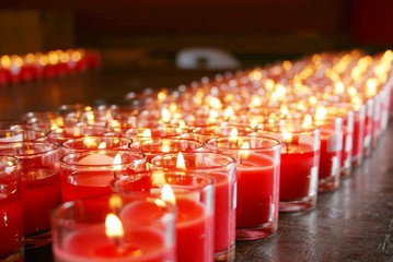 red burning candles in a temple