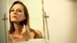 woman applying blush and makeup