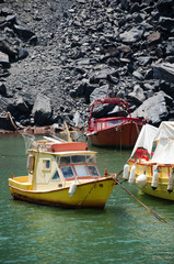 Boats by the Hot Springs in the sea by the Volcano Santorini