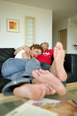 Couple asleep on the sofa