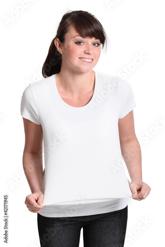 Attractive young girl trying on a shirt