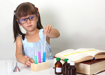 child girl making science test