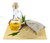 Sack of sesame seeds and glass bottle of oil