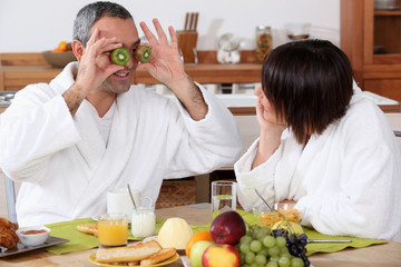 Couple having breakfast in bathrobe