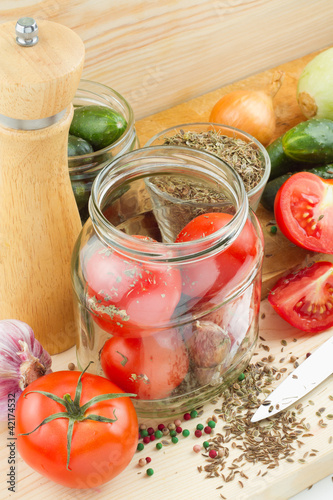 canned tomatoes and cucumbers, homemade preserved vegetables