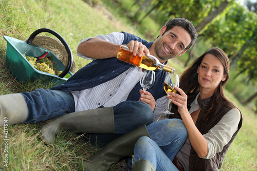 Couple with wine in the field