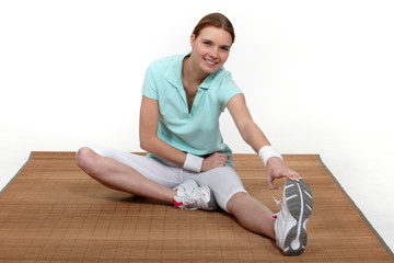 Woman sitting stretching