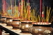 Incense or joss sticks burning in jars