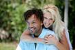 Woman embracing man outdoors