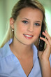 Blond office worker making phone call