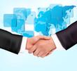 Handshake between business people with map.