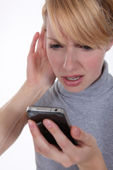 Woman struggling to hear her phone