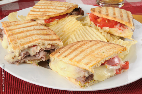 Grilled roast beef panini with potato chips