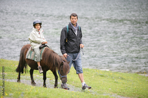 boy riding a pony