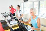 Young people on fitness treadmill running exercise