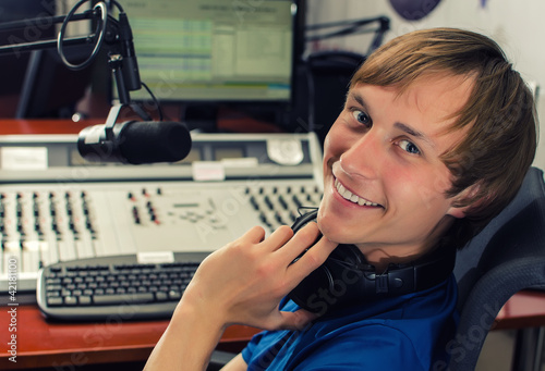 Dj in front of a microphone on the radio