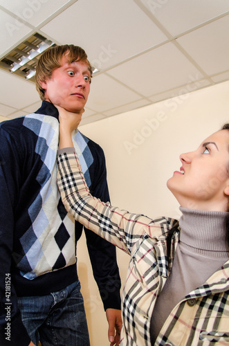 Office fight: Woman trying to stifle a man