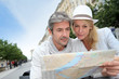Middle aged couple looking at city map