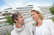 Happy romantic couple standing in front of cruise boat