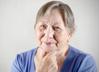 Sad old senior woman