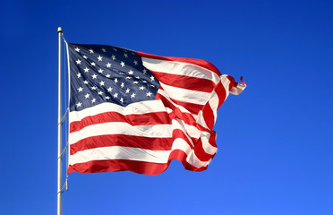 USA American flag against blue sky