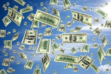 hundred dollar bills flying in the air