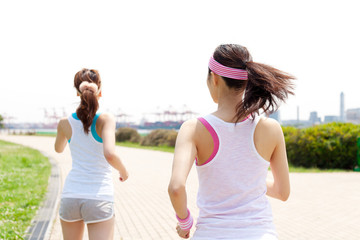 Beautiful young women running. Portrait of asian.
