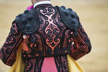Detalle del vestido de torear rosa y azabache.