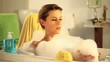 woman who has fun in a bath with foam