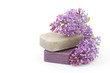 two bars of natural soap and lilac flowers