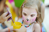 Adorable girl getting her face painted - Fine Art prints