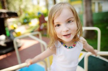 Cute little girl funny portrait outdoors