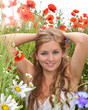 Spring: young woman relaxing in a field of spring flowers