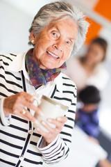 Elder woman drinking coffee