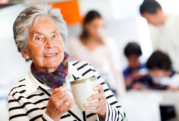 Old woman with a cup of tea