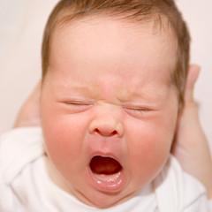 crying newborn. Something bothers him.