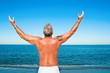 Topless man praising
