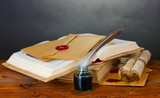 old books, scrolls, feather pen and inkwell