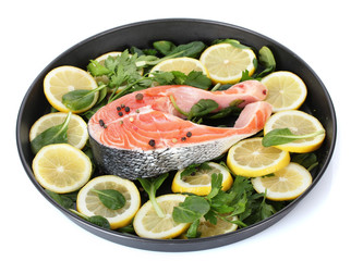 Red fish with lemon, parsley and pepper
