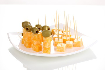 Cheese canapes on plate isolated on white