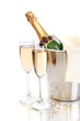 Champagne bottle in bucket with ice and glasses of champagne,