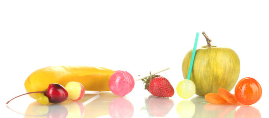 A lot of tasty lollipops with fruit isolated on white