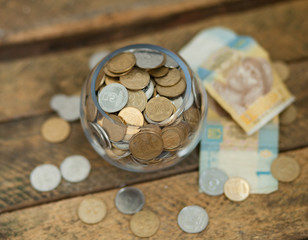 Ukrainian coins and hryvnas shows poverty
