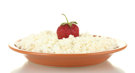 Cottage cheese with strawberry in a plate isolated on white