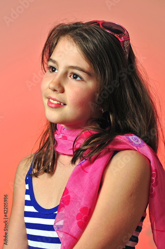 smiling thinking teen girl  with pink scarf looking up