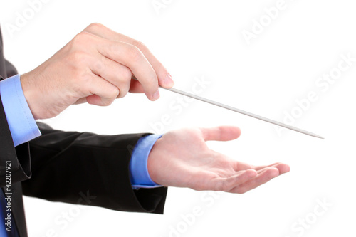 Music conductor hands with baton isolated on white