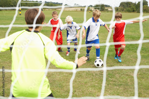 Player ready to score goal in Junior 5 a side