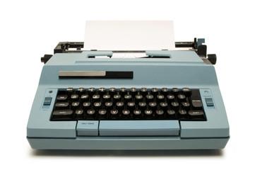 Blue electric typewriter on white